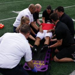 training in preparing an injury player for transport off a football field