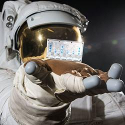 astronaut holding kidneys on a chip NASA