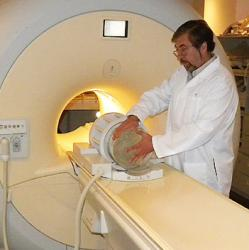 picture of Vasily Yarnykh positioning an object to test an MRI scanner