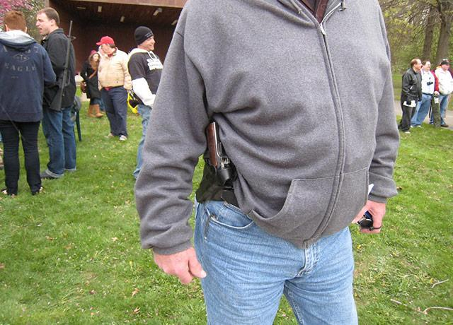 picture of a man openly wears a handgun in a holster