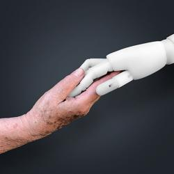 picture of older woman and robot holding hands