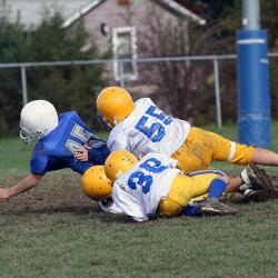 boys playing tackle football
