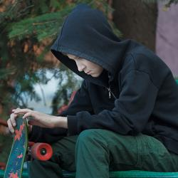 Teen and his skateboard