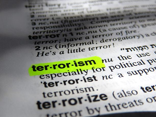 "picture of the word ""terrorism"" highlighted in a dictionary"