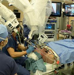 picture of surgical assistants during a procedure to remove cancer involving a tonsil