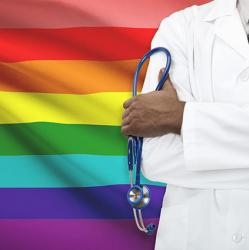 picture of doctor in front of rainbow flag