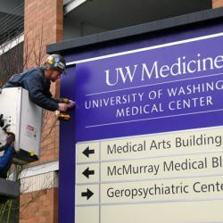 picture of worker installing sign at UW Medical Center – Northwest in Seattle
