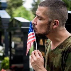 vet kissing a small flag