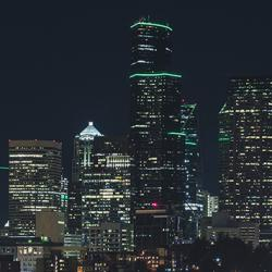picture of green lighting on downtown Seattle buildings