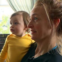 Kristina Katrel holding her son
