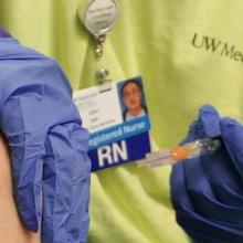 Nurse getting ready to give a flu shot
