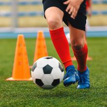 Child doing soccer drills