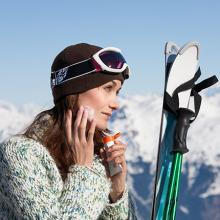 Woman applying sunscreen before skiing