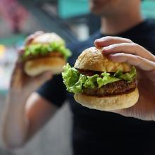 Man holding vegan burger