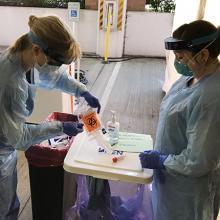 Nurses opening a coronavirus test kit