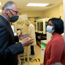 picture of Gov. Jay Inslee talking with Pavitra Roychoudhury