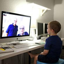 Boy video chatting with grandparents