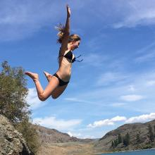 Lily James jumps into a swimming hole.