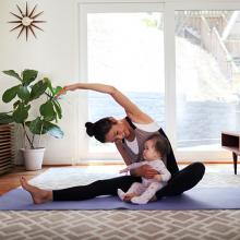 Mom exercising with child at home