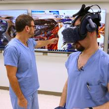 Doctor demonstrating the use of virtual reality to get a better view of hearts