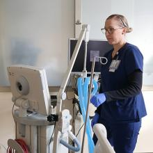 Respiratory therapist working with a ventilator