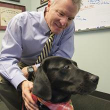 """Dr. Martin """"Casey"""" Childers and the Bella, matriarch of his research into myotubular myopathy, a muscle-wasting disease."""