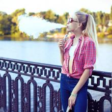 picture of teen girl using a vape