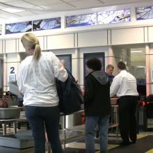 People going through security at the airport