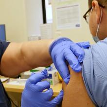 Nurse giving a COVID-19 vaccine dose