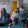 picture of adolescents entering a school classroom