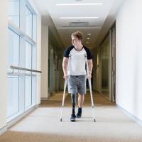 Amputee walking in a hallway