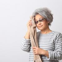 picture of woman wiping sweat from her brow