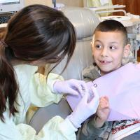 picture of a boy getting dental care from a UW Dentistry resident