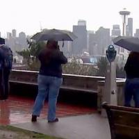 picture of people with umbrellas in Kerry Park in Seattle