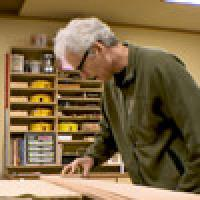picture of carpenter Michael Barton sanding wood