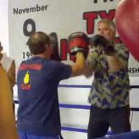 Bret Summers, left, coaches a Parkinson's patient at his gym.