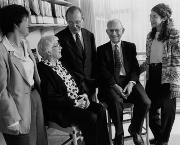 archival photo of George Stamatoyannopoulos and colleagues